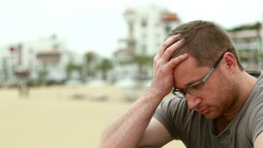 Sad pensive man sitting by the beach, outdoors - HD stock ...