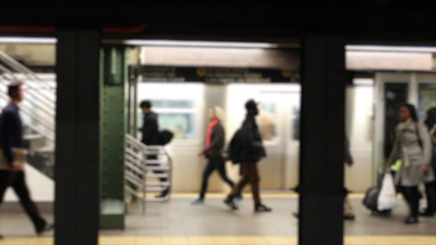 Horizontal HD clip of commuters in a New York subway station, blurred to prevent identification. | Shutterstock HD Video #2050706