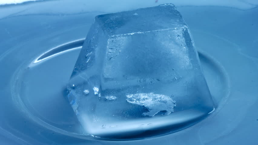 time lapse of melting of ice cube stock footage video