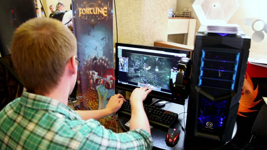 A Young Man Playing Video Games On Joystick Gamepad And