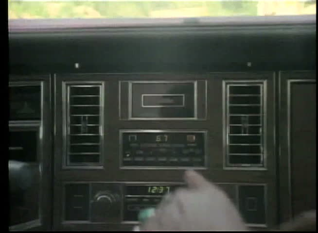 Close-up of male hand tuning car radio - SD stock footage clip