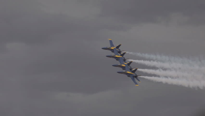 ST GEORGE, UTAH - MARCH 17: Navy Blue Angel demonstration fighter jets fly by in close formation on March 17, 2012 in St. George, Utah. Yellow and blue supersonic F18 Hornet aircraft in finger tip formation