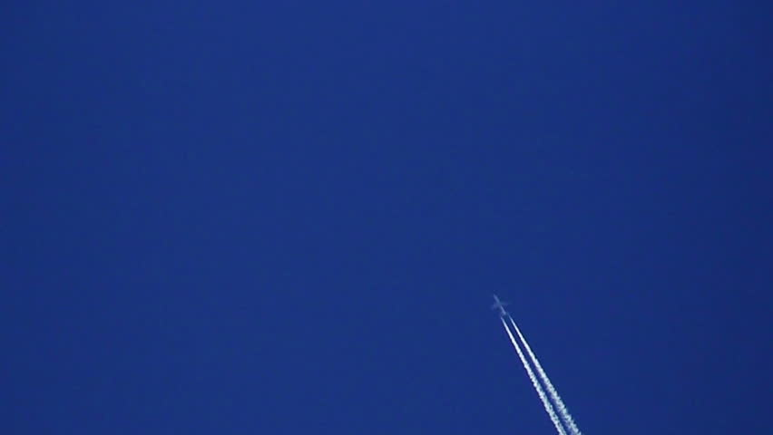 Airplane vapour trails across clear blue sky 3 - HD stock footage clip