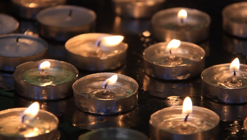Spiritual candles in a church - HD stock footage clip