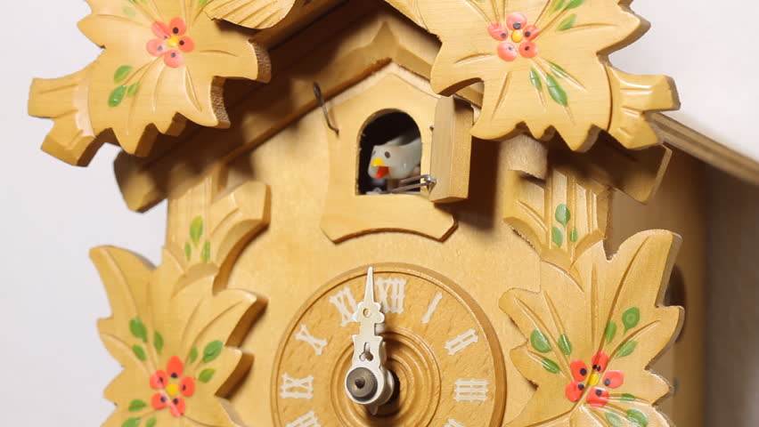 Cuckoo Clock Twelve Chimes (HD). Vintage style Cuckoo clock chimes twelve times showing bird while camera changes angles from the ticking pendulum to the house bird. Audio included.