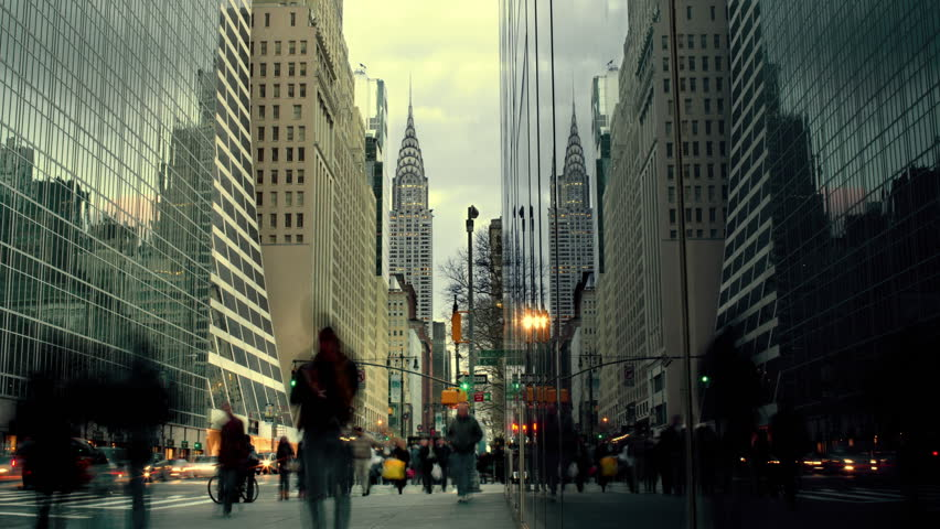 Timelapse People walking on Busy, Crowded street in Midtown Manhattan New York City, with Chrysler Building in Background, Day to Night, NYC, USA