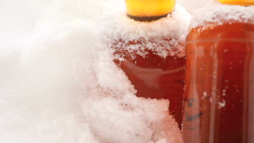 Beer left outside in snowy cold weather. - HD stock footage clip