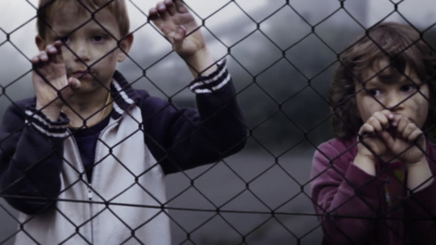 Children's loneliness. Abandoned. Homelessness. Orphans in slums. Video clip shows lonely children. Orphans in the refugee camp. Static Shot. Clip ID: children4_HD - HD stock footage clip