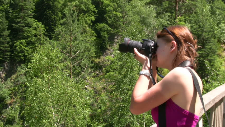 Photographer taking pictures in nature,panning - HD stock video clip