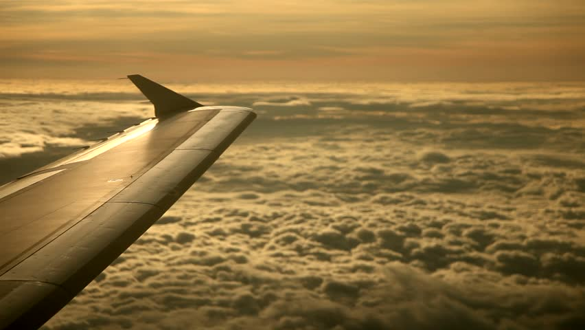 flight over clouds in the sunset - HD stock footage clip
