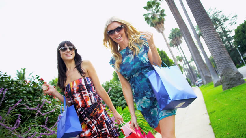 Young girlfriends on a shopping trip - HD stock footage clip
