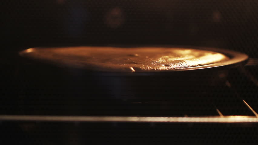 cake baked in the oven. Time Lapse