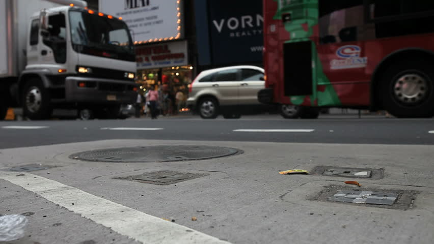 New York - Circa 2009: Times Square in 2009.  Times Square street with pedestrians and steam grates in New York City, New York. - HD stock video clip