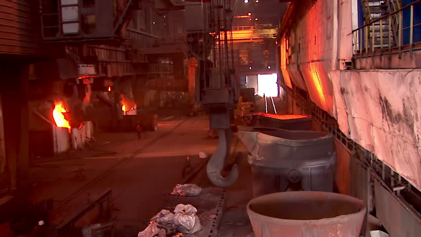 Iron and Steel Works. Converter plant. Loading scrap metal into a melting furnace. - HD stock video clip