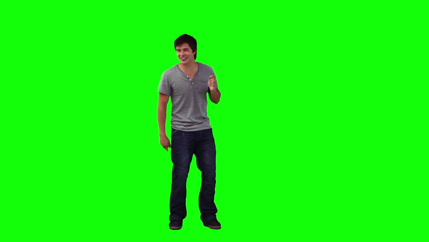 portrait of young man standing against green screen male