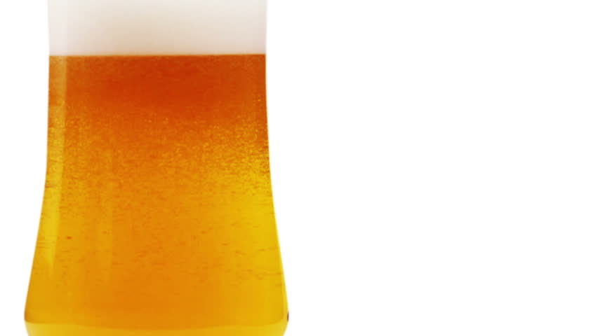 Fresh beer with froth and condensed beer  drops. Alpha matte - HD stock footage clip