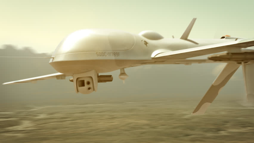 Military drone (UAV) flying over desert and actively seeking enemy targets.
