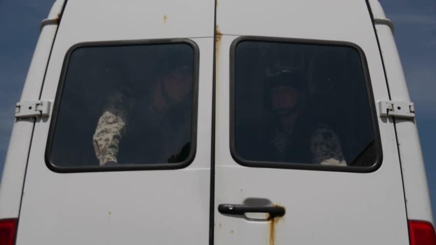 Soldiers leaving van