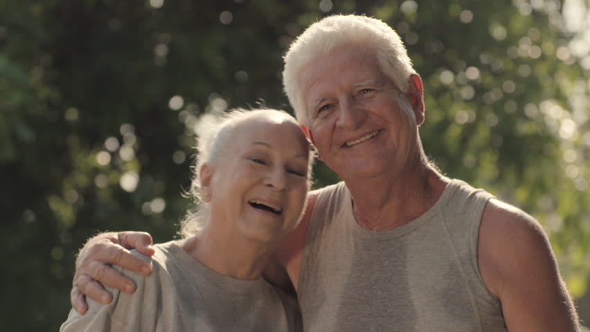 Active retired people and sport, portrait of happy senior husband and wife after fitness and jogging in city park | Shutterstock HD Video #2360477