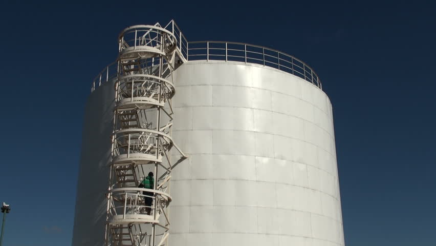 The worker up the stairs to the top of huge oil tanker.   Shutterstock HD Video #2368865