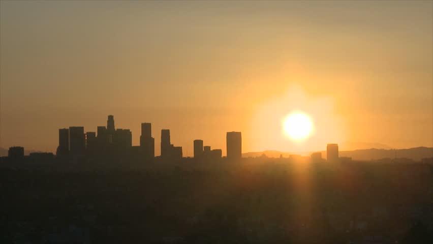 Sunrise with heat haze of Downtown Los Angeles skyline | Shutterstock HD Video #2384129
