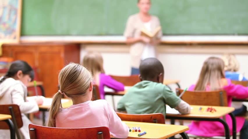 Cute children raising their fingers in the classroom - HD stock video clip
