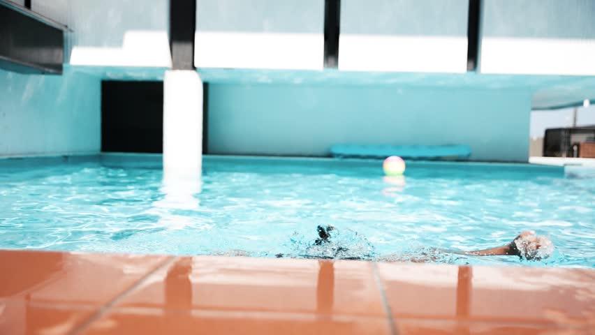 Beautiful woman having fun in a resort swimming pool, relaxing in the water and sunbathing | Shutterstock HD Video #24240872