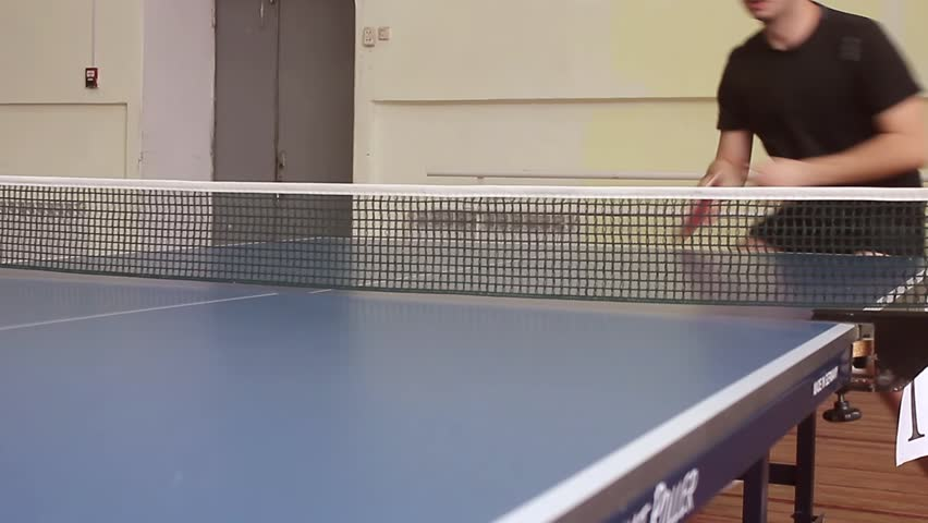 Young sports man tennis-player in play on old gym. Action shot.   Shutterstock HD Video #24251015