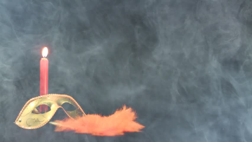 Mask, fan and candle on black background in smoke - HD stock video clip