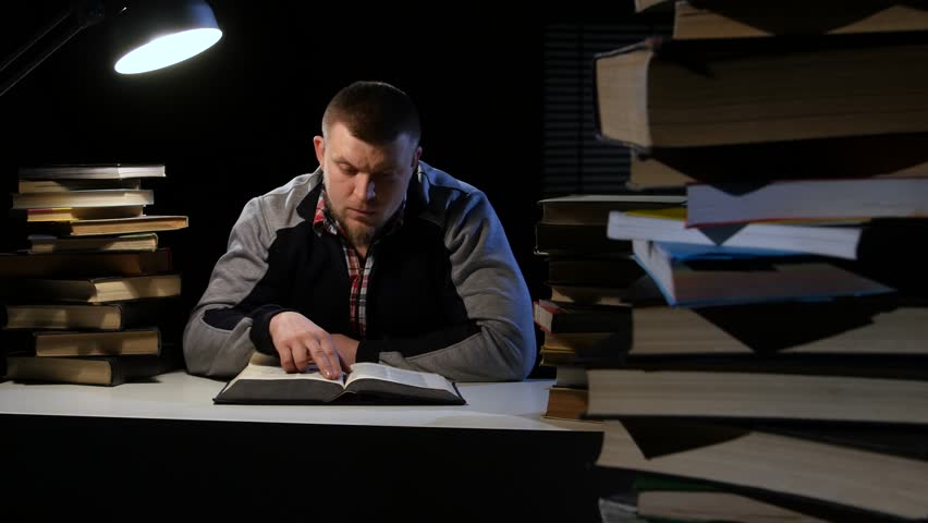 Man leafing through the book and found it was looking for so long. Black background | Shutterstock HD Video #24259403