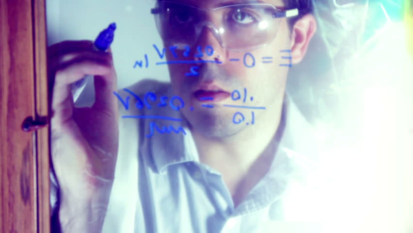 Chemist writing down some chemical equations. - HD stock video clip