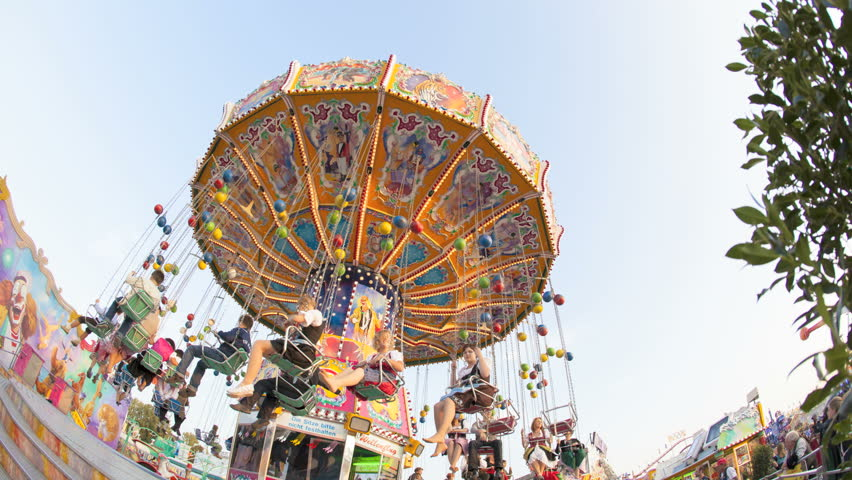 MUNICH - SEP 23: A Chairoplane timelapse with people in the air at the