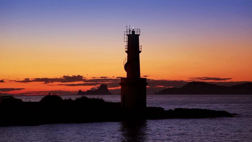 Ibiza island sunset of Es Vedra and La  Savina lighthouse in Formentera - HD stock video clip