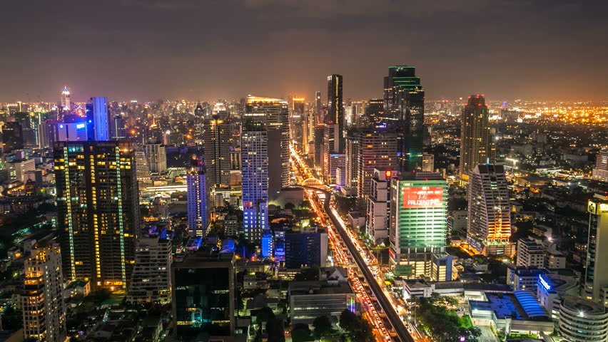 BANGKOK - JUNE 24, 2012: Timelapse view on Sathorn street of skyline at night on