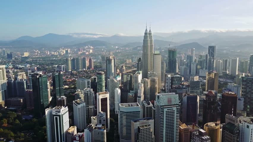 Aerial view of kuala lumpur cityscape. Drone video of asian scyscrapers. Blurred all logotypes.