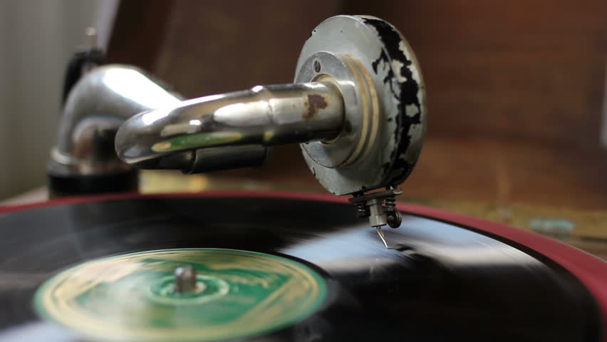 Vintage gramophone playing music from black vinyl