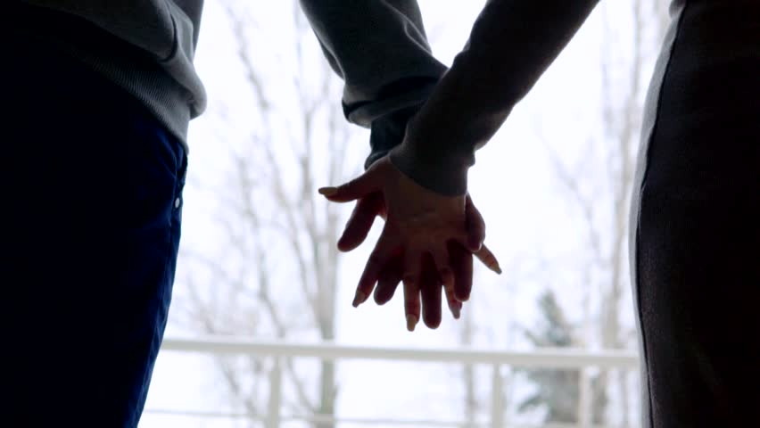 Close up of two Lovers Joining Hands. Detail Silhouette of Man and Woman holding hands. Couple Trust, Love and Happiness concept. | Shutterstock HD Video #24515948