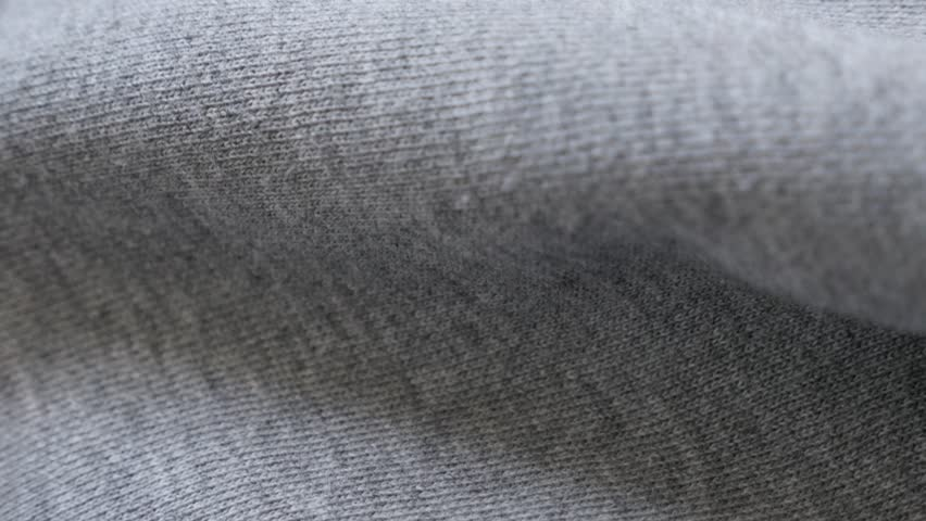 Fine sweating  shirt or pants fabric texture close-up 2160p 30fps UltraHD tilting footage - Cotton training piece of cloth slow tilt 4K 3840X2160 UHD video | Shutterstock HD Video #24524237