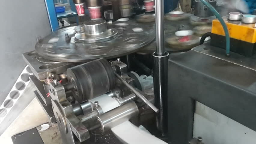 KOLKATA, WEST BENGAL / INDIA - FEBRUARY 23RD : Industrial Paper cups being manufactured in machine, high speed production from rotating machine parts, HD footage of automated machinery, on 23.02.2017. | Shutterstock HD Video #24548303