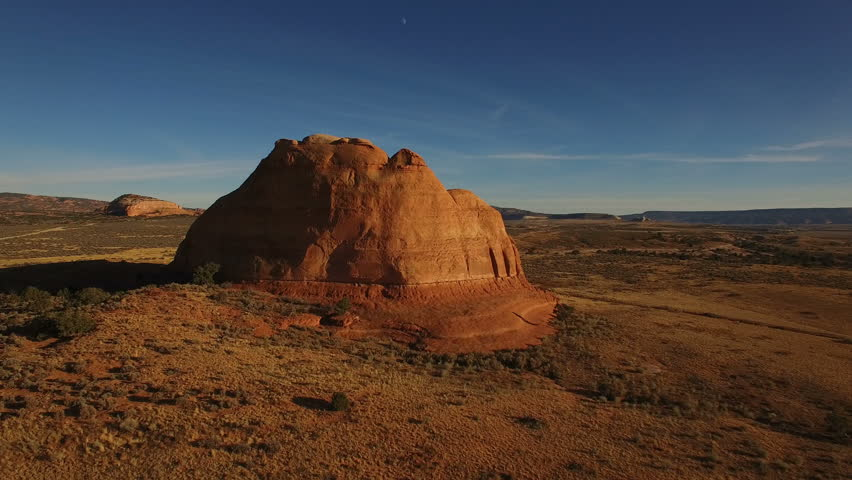 Drone aerial long HD video - Moab desert geology - flying approach on colorful monolithic rocks