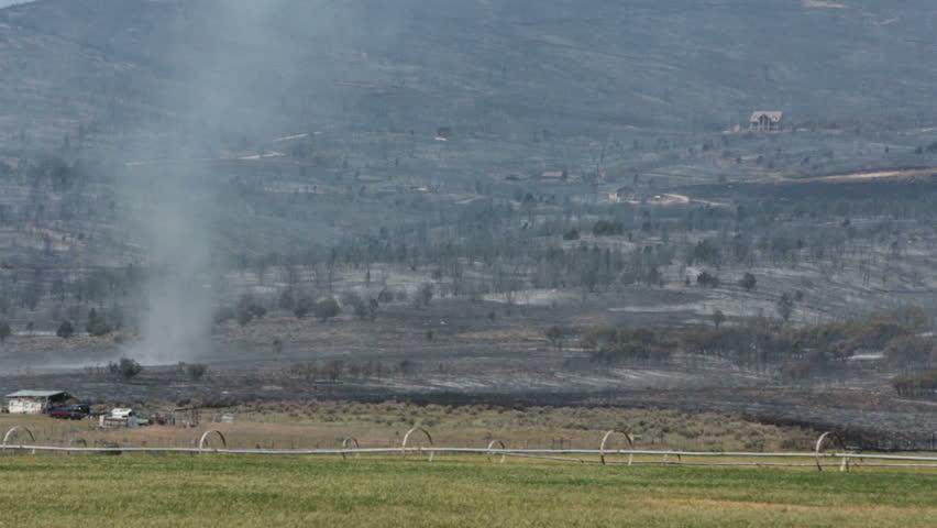 FOUNTAIN GREEN, SANPETE, UTAH 25 JUN 2012: Mountain wildfire tornado twister across burn. Fire intense flames out of control. Dangerous and destructive blaze. Wood Hollow Utah. FEMA. Drought winds. - HD stock footage clip