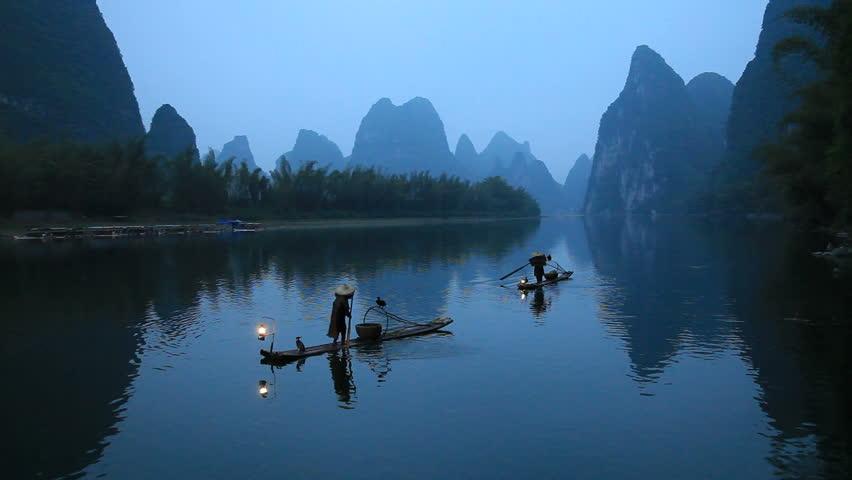 Fishing with cormorants on Li River, Guilin, Guangxi Province, China.