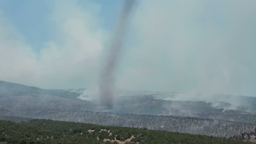 FAIRVIEW, SANPETE, UTAH 25 JUN 2012: Tornado whirlwind forest wildfire. Fire intense flames out of control on mountain. Wood Hollow central Utah. FEMA Federal Government help. Drought strong winds. - HD stock video clip