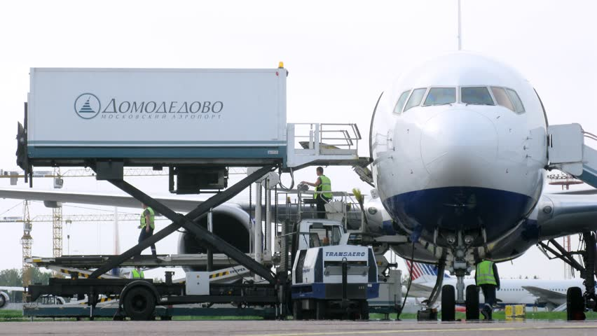 MOSCOW - MAY 22: (Timelapse View) Workers unload cargo from plane, on Domodedovo airport, on May 22, 2012 in Moscow, Russia