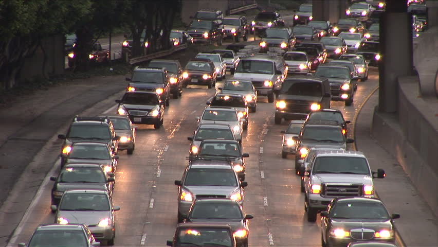 Los Angeles, CA - CIRCA February 2006: Heavy traffic on the freeway at dusk is a dangerous time for drivers  - HD stock footage clip