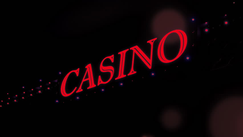 Red casino sign with flashing lights at entrance to casino glows in the dark. (av34533c) | Shutterstock HD Video #24771251