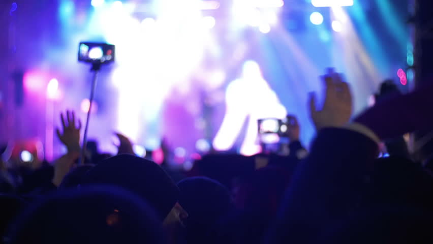 Blurred Concert Crowd at Music Festival. Crowd people dancing Rock concert, weighed, applauds, raises his hands up and photographed, filmed concert on the phones and smartphones. Party People In Action. Crowd | Shutterstock HD Video #24779846