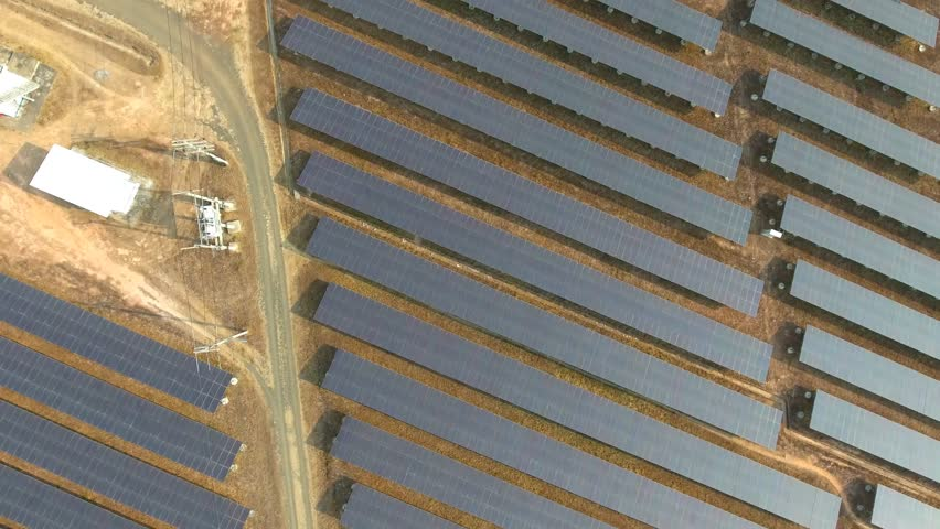 Aerial view large industrial Solar Energy Farm producing concentrated solar energy. Solar Energy Farm at Thailand  | Shutterstock HD Video #24784670
