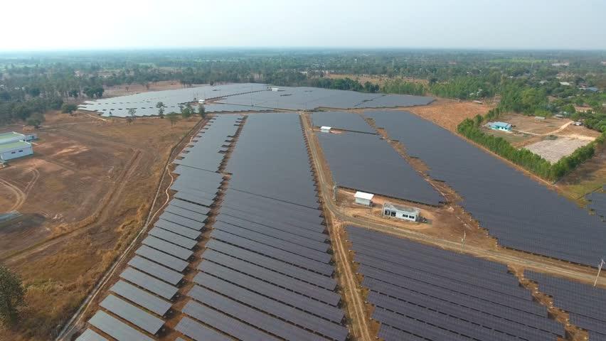 Aerial view large industrial Solar Energy Farm producing concentrated solar energy. Solar Energy Farm at Thailand  | Shutterstock HD Video #24784679