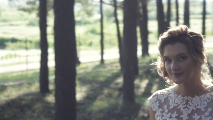 Bride and groom walk through the forest and talk close-up | Shutterstock HD Video #24834125